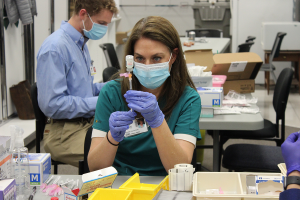 hcp preparing a vaccine